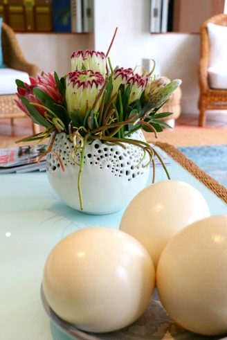 South African elements, like the Protea and ostrich eggs are common features