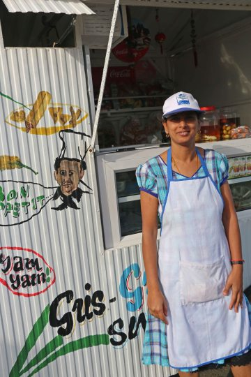 Poonam in front of her snack stall at Gris Gris