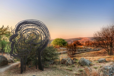 The rolling hills, laden with ancient fossil where we can all trace our origin , gives the sculpture so much more meaning