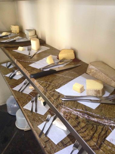 Compose your own cheese platter in the walk-in cheese room