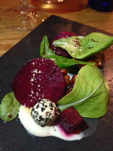 Beetroot salad, goats cheese, candied walnuts, beetroot ravioli, sumac and hazelnut dressing