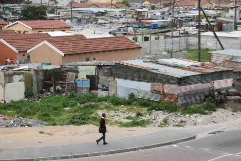 A young boy walking to school in the township